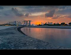 Slither the tangerine (HakWee) Tags: sunset singapore marinabarrage marinabaysands