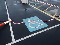 A symbolic beheading (Jennifer Lea) Tags: symbols signs semiotics disabled tape fall beheading line rain southmelbourne city cold mornings blue concrete walks shape