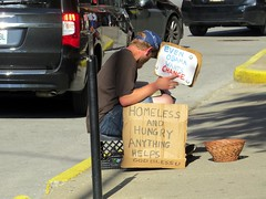 A panhandler who keeps up on current events and Obama. (kennethkonica) Tags: life street city people urban usa men hat sign america canon midwest sitting shadows basket random outdoor candid indianapolis seat streetphotography fake indy indiana cardboard sit persons seated economy begging panhandler annoying alternative beg global canonpowershot currentevents hoosier marioncounty publicnuisance presidentobama
