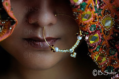 An Indian woman...DSC_0016 (subirbasak) Tags: portrait people india colour beauty closeup gold veil serious makeup jewellery nosering sari beautifulpeople calcutta confidence traditionalculture westbengal nosepiercing subirbasak traditionallyindian traditionalornamentsofindia gettyimagesindiaq4
