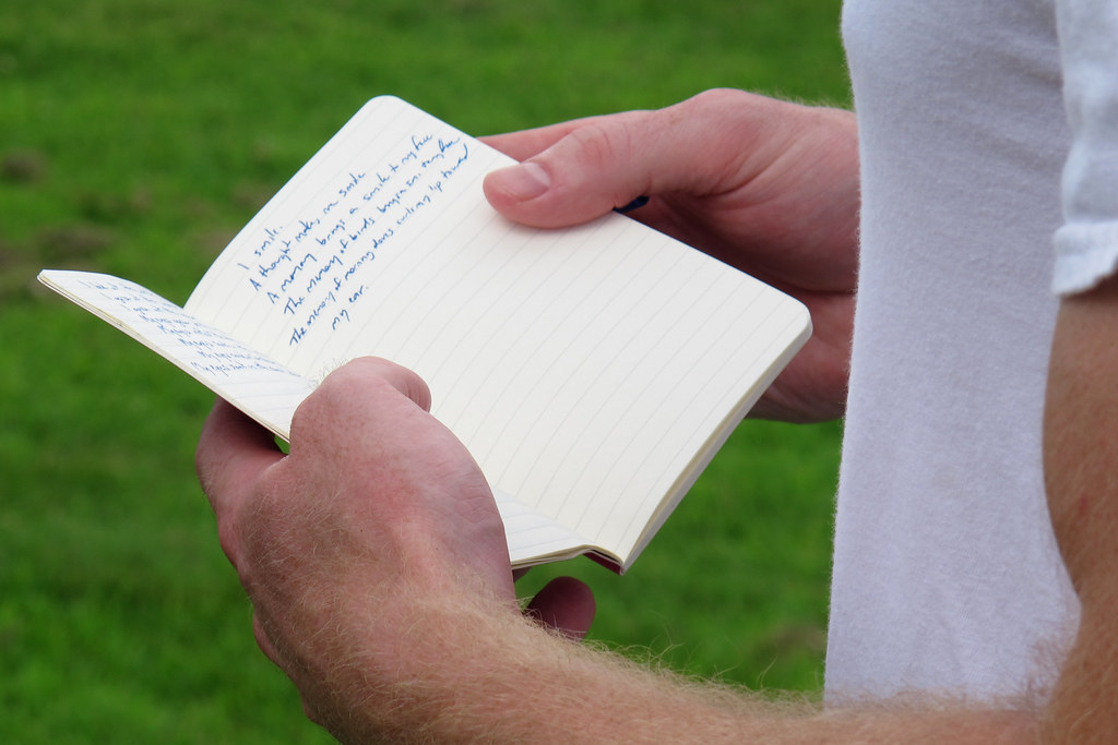 As teams gather, a poet's notebook is repurposed for keeping track of the batting order. (Karen Given/Only A Game)