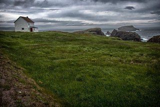 Little White House with a red door in Elliston, Newfoundland