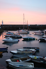 Mevagissey (WelshTart) Tags: light sea summer england sky sun lighthouse beach water clouds sunrise buildings reflections boats dawn coast rocks cornwall harbour earlymorning scenic walls mevagissey