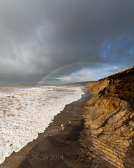 Compton Bay Rainbow - IMG_2015 (s0ulsurfing) Tags: uk winter sea england black green english beach rain weather clouds canon dark island coast march spring rainbow waves skies darkness compton shoreline wave stormy coastal shore isleofwight coastline isle wight 2014 westwight comptonbay s0ulsurfing jasonswain
