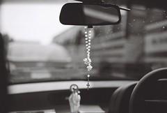Protection (Gwenaël Piaser) Tags: blackandwhite bw macro film window car analog zeiss canon photography eos 50mm prime mirror beads reflex cross noiretblanc kodak iso400 prayer religion wb voiture nb retro christian negative carl 135 fullframe retroviseur thanjavur makro kodakbw400cn canoneos tamil 1000 tamilnadu ze 400asa croix argentique inde nadu planar 400iso negatif chretien prayerbeads eos50e carlzeiss tanjore inda 400cn bw400cn c41 makroplanar christianisme 24x36 canoneos50e chapelet elaniie unlimitedphotos gebetskette gwenaelpiaser makroplanart250 makroplanar50mm makroplanar502ze carlzeissmakroplanart250 zeissmakroplanart250ze eos55p canoneos55p zeiss50mmmakroplanarze analogcanonelaniie