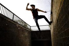 The Reach - Salisbury, UK (Janicskovsky) Tags: lighting uk portrait man male guy slr silhouette sport wall project person jump model nikon university flash gb tanktop salisbury activity athlete wiltshire leap parkour dlsr walljump d7000 nikond7000