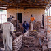 Young men learn bricklaying skills at the Vocational Training Institute built by TAO, Uganda, 2005