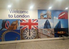Welcome to London (Stuart Axe) Tags: uk greatbritain england signs london sign towerbridge mural unitedkingdom heathrow flag taxi londoneye bigben gb terminal3 unionjack unionflag gherkin k6 arrivals heathrowairport downingstreet telephonekiosk airportsigns theshard theelizabethtower