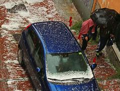 under the hail (ludi_ste) Tags: white hail town citylife genoa genova today citt hailstones grandine