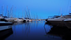 Dancing on the water (gcarabin) Tags: blue reflection boats harbor