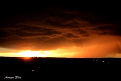 Sunset storm (moniquef123) Tags: sunset sky orange storm nature clouds dark landscape texas ominous thunderstorm therebeastormabrewin