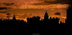 Ciel de Feu sur Édimbourg (Frédéric Fossard) Tags: nuage lumière édimbourg écosse château clocher coupole ombre silhouette abstrait surréaliste grain texture contraste croix noir orange goldenhour