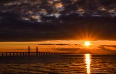 Sunset (Maria Eklind) Tags: bridge sunset sea sky sun reflection beach nature water clouds strand se europe sweden outdoor himmel sverige malm solnedgng moln resund sibbarp resundsbron horisont spegling skneln