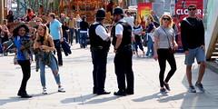 Line of Duty? (canonsnapper) Tags: street streetphotography police olympus policeman omd em5 olympusomdem5