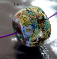 Haze (Laura Blanck Openstudio) Tags: show blue urban usa abstract green art glass festival silver necklace beads leaf big sand shiny colorful aqua published artist european purple handmade eggplant turquoise metallic teal fine arts almond violet lavender plum funky jewelry charm holes made odd lilac earthy single donut round winner bead iridescent organic kiln murano iridescence grape lampwork multicolor raku artisan pendant whimsical frit openstudio asymmetric ocher focal speckles silvered annealed openstudiobeads