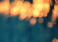 Blue bokeh background.Orange lights. (ManhDesign.Inc) Tags: christmas xmas eve blue light orange sunlight holiday abstract black color art nature water yellow glitter night contrast silver dark circle festive stars happy gold golden design glamour pattern glow shine purple symbol bokeh background space magic flash year decoration magenta blurred fair garland illuminated event card merry elegant blink snowfall sparks decor celebrate element textured defocused backdrops orangelights waterbackground