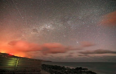 Orange Sky at night (Stephen Bowden) Tags: light orange seascape nightscape astrophotography pollution astronomy milkyway