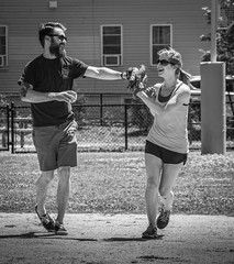 Softball Siblings (mgstanton) Tags: july4 softball highfive bw siblings
