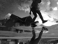 Dancing in the rain (DanielHiller) Tags: dancing jump sprung himmel heaven sky wolken cloud haus house strase street pftze schwarz weis black white bw spiegelung deutschland niedersachsen germany schneverdingen