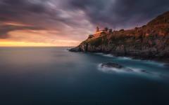 Faro de Cudillero (Asturias, Spain) (Tomasz Raciniewski) Tags: longexposure sunset sea sky espaa lighthouse seascape color clouds landscape faro atardecer mar spain outdoor wide sigma asturias 1020 cudillero haida cantabrico nd400 d3200
