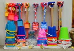 Buckets & Spades (alderney boy) Tags: pink vacation orange colour green shop toy seaside bucket label tag rack spade looe