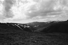 Gygerhoe (IggyRox) Tags: light sky blackandwhite mountains film nature beauty norway clouds 35mm norge europe view north hike scandinavia rondane oppland grimsdal gygerhoe