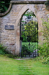 The Garden Gate (zinnia2012) Tags: wroughtiron gate garden roundwindow grass steppingstones wall cotswoldvillage charlbury england archway greenery