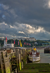Across the Bay (NoVice87) Tags: light sea sky lighthouse clouds boat harbour scarborough northyorkshire coronia