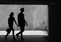 Underground walkway (mkorolkov) Tags: street city light shadow people urban blackandwhite monochrome silhouette underground walking couple walk streetphotography walkway fujifilm xe1 xc50230