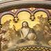 La obra de 'Cristo en Majestad' fue pintada sobre el marco de la puerta por el artista Francisco Javier Amérigo. El Cristo sedente, en actitud de bendecir, sostiene en su mano izquierda el orbe rematado por la cruz. A su lado, cuatro ángeles arrodillados le rodean, dos de ellos moviendo incensarios que expanden el humo del incienso. Tras ellos, coros de ángeles alaban al Señor.  En la parte superior sobresalen los rostros de cuatro angelitos, un detalle en altorrelieve en dorado que remata el conjunto.