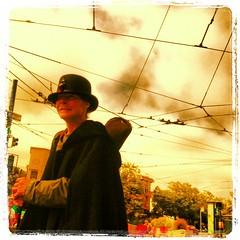 man wearing hat on castro and market #94114 #castro #uppermarket #sanfrancisco #fashion #street #style #hat #weather #instagram #webstapick #lynnfriedman @lynnrfriedman #iphone #app #clouds (Lynn Friedman) Tags: instagramapp square squareformat iphoneography uploaded:by=instagram lordkelvin 94114 castro lynnfriedman sanfrancisco