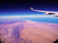 Leaving Africa (Stella Ortiz) Tags: ocean africa travel sky plane landscape flying view air flight wing namibia atlanticocean windowseat