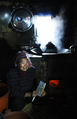 Granny in the kitchen (Mel@photo break) Tags: life china house tree kitchen field rural countryside corn village hill cook culture mel layer farmer tradition melinda agriculture yunnan granny ethnic minority chengzi    yiminority  chanmelmel  melindachan chengzioldvillage