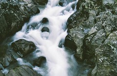 Wild river (Tom Spearing) Tags: longexposure film water rock wales analog 35mm landscape flow photography rocks pentax superia rapids 400 fujifilm flowing analogue ceredigion mesuper xtra cwmystwyth uploadedviaflickrqcom photographersontumblr tomspearing