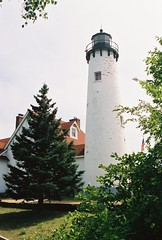 Point Iroquois lighthouse (Upper Michigan) (stevelamb007) Tags: trees usa lighthouse building us michigan flag oldphoto lakesuperior uppermichigan pointiroquois stevelamb