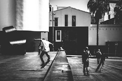 Urban (-Andi) Tags: street plaza trip travel viaje light people urban bw white black blanco luz boys sport contrast buildings square outdoors calle movement edificios mood moody shadows exterior gente negro young style atmosphere movimiento skaters skate contraste deporte estilo urbano atmosfera sombras chicos jovenes escapade