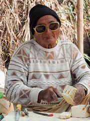 Sicilian Man processed stone to souvenir (LYSVIK PHOTOS) Tags: portrait people italy outdoors photography souvenirs glasses tools handicrafts oneperson handcraft marsala colorimage salino photographyimage