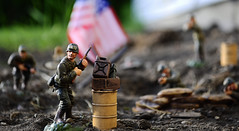 Miniature Battles (Amazing Backgrounds) Tags: viral explore view views popular flickr mini miniature miniatures battle fight gun fire soldier soldiers american america usa infantry flag pole material cotten barrel weapons guns ww2 sandbags cover curious dirt go run move hold action shot army airborne 82nd jerry can gasoline gas camera attack depthoffield confused discovery object battlefield fake replica forces valor toy figure sand rocks shots forth july independance unitedstates real life scary approach approaching