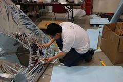 """Steven makes shiny covers for the port holes • <a style=""""font-size:0.8em;"""" href=""""http://www.flickr.com/photos/27717602@N03/27528932486/"""" target=""""_blank"""">View on Flickr</a>"""