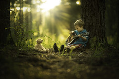 Teddy Serenade (Phillip Haumesser Photography) Tags: park morning trees friends light boy summer portrait people music sun sunlight green art nature boys kids forest sunrise children fun outside outdoors happy kid woods friendship teddy sony mandolin 85mm naturallight missouri teddybear littleboy ozarks serenade philliphaumesser sonya7ii barnhollownaturalarea