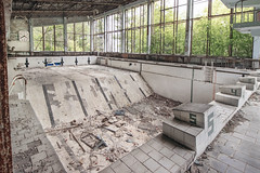 In at the deep end, Pripyat (Sean Hartwell Photography) Tags: plants abandoned pool swimming concrete accident decay empty radiation nuclear dry diving ukraine disaster radioactive 1986 derelict sovietunion crumbling fallout chernobyl endtimes postapocalyptic 30years pripyat withoutpeople