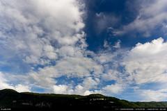 24/52 : A new dimension (Ludtz) Tags: blue sky mountain alps green clouds montagne alpes canon spring vert bleu ciel nuages 74 printemps salve 14mm canoneos60d cloudsstormssunsetssunrises ludtz 14 28