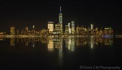 Night Reflections (Snia CM) Tags: longexposure light newyork skyline night reflections river lights fuji manhattan fujifilm reflejos largaexposicion llargaexposicio fujixt1