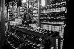 Shoes (Abdulaziz Ceylan) Tags: life street door light portrait people urban blackandwhite bw man motion black reflection building eye nature monochrome lines architecture night work turkey underground photography photo alley raw place floor photos outdoor live sony crowd deep streetphotography streetlife oldman istanbul structure symmetry sidewalk wash human historical bazaar curve fujinon candit rx1 streetvision