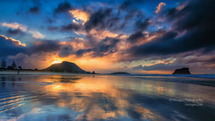Boom... (muzzpix-nz) Tags: blue sunset newzealand reflection beach clouds golden sand tide shoreline stormy mount shore nz rough mountmaunganui taystreet