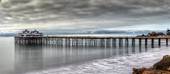 Malibu Pier Extended (Wilkof Photography) Tags: ocean california ca longexposure winter light shadow sea sky panorama reflection geometric beach nature wet water rain skyline architecture 35mm canon dark lens landscape outside coast pier countryside seaside cafe sand rocks surf waves waterfront cloudy hiking tide horizon rustic perspective scenic windy overcast panoramic boulder symmetry malibu pacificocean socal le nd land americana serene roadside hazy hillside cloudcover beachfront cpl fishingpier rockformation oceanfront oceanscape neutraldensity malibupier 18135mm nd1000 canont4i wilkofphotography