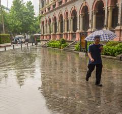Shanghai-streets 12 (stevefge) Tags: china shanghai street people rain candid wet umbrellas reflections puddles reflectyourworld