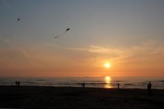 Kites (Robin@Home) Tags: ocean sunset sky people cloud sun kite beach water clouds sunrise evening wind nederland noordzee kites wassenaar