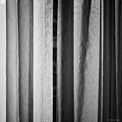 Parted curtains (Paul Perton) Tags: street urban blackandwhite bw abstract vancouver square zeiss25mmtbiogonf28