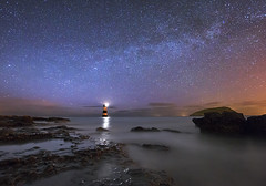 'Seiriol's Starlight' - Black Point, Anglesey (Kristofer Williams) Tags: sea sky lighthouse beach night stars landscape coast astrophotography blackpoint milkyway anglesey penmon ynysseiriol puffinisland noctography lighthousetrek